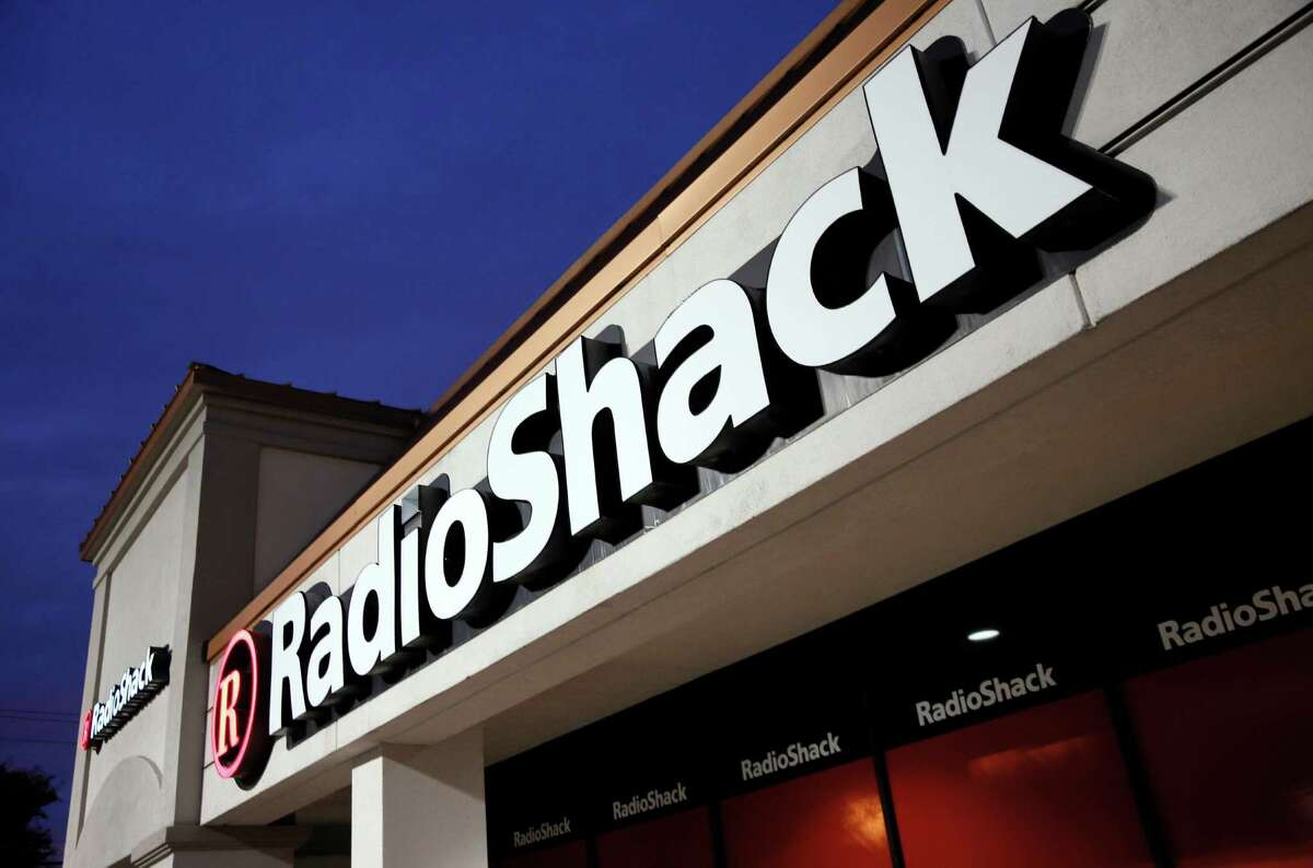 FILE - This Tuesday, Feb. 3, 2015 file photo shows a RadioShack store in Dallas. The electronics retailer filed for Chapter 11 bankruptcy protection on Thursday, Feb. 5, 2015. (AP Photo/Tony Gutierrez, File) ORG XMIT: NYBZ160