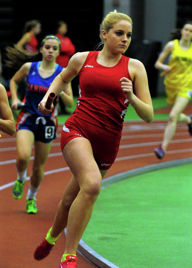 Greenwich's Jenny Goggin competes in a heat of the 4X800 meter relay, during FCIAC track championship action in New Haven, Conn. on Tuesday Feb. 5, 2015. Photo: Christian Abraham / Connecticut Post