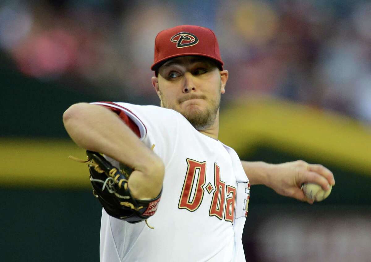 PHOENIX, AZ - APRIL 28: Wade Miley #36 of the Arizona Diamondbacks delivers a first-inning pitch against the Colorado Rockies at Chase Field on April 28, 2014 in Phoenix, Arizona. (Photo by Norm Hall/Getty Images) ORG XMIT: 477582615