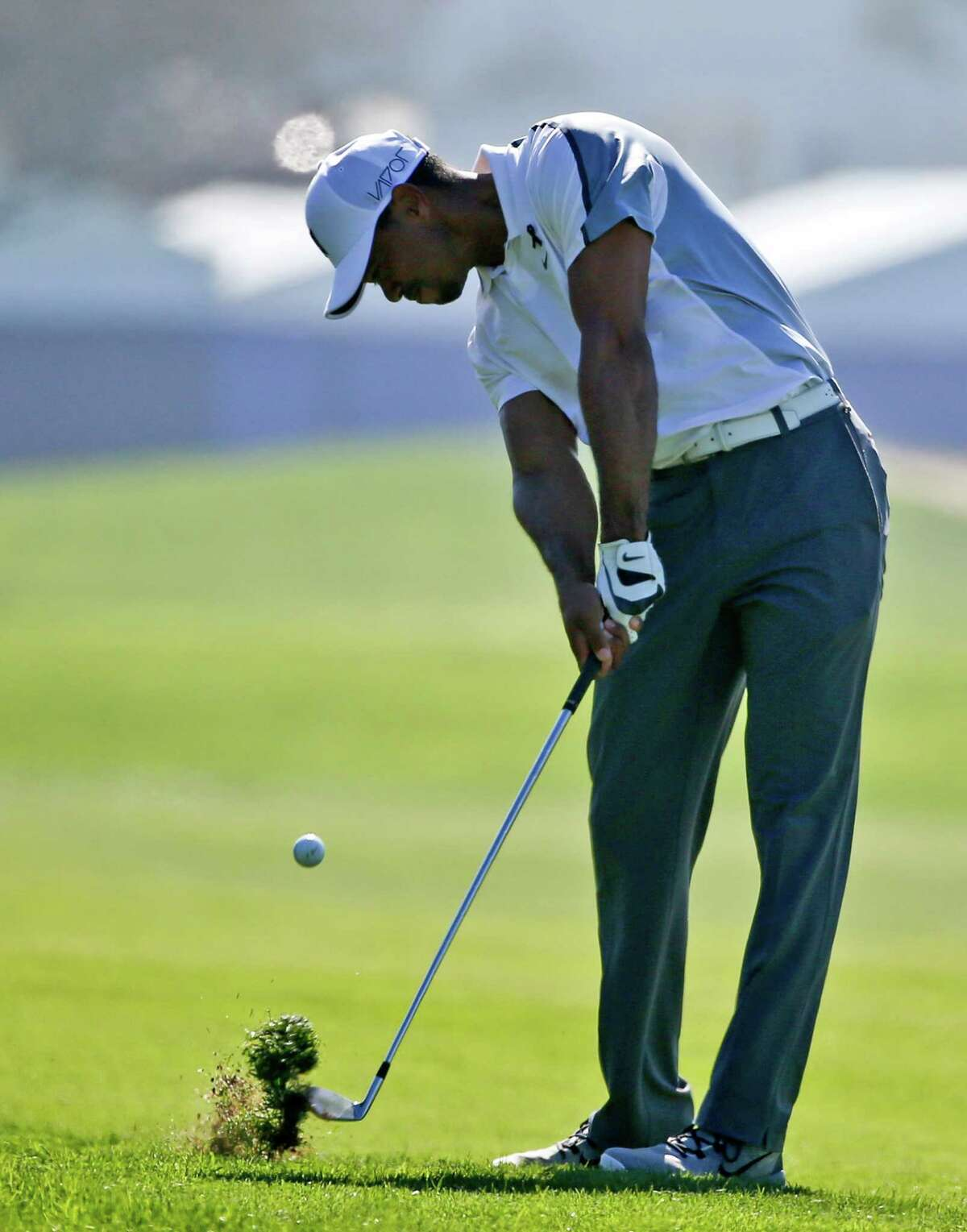 Tiger Woods hits his approach shot to the 10th hole (his first) on the north course at Torrey Pines during the first round of the Farmers Insurance Open golf tournament Thursday, Feb. 5, 2015, in San Diego. Woods missed the green with the short shot and made bogie. (AP Photo/Lenny Ignelzi) ORG XMIT: CALI105