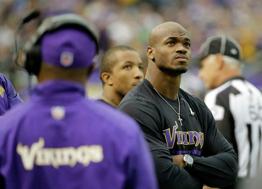 Vikings running back Adrian Peterson has been stranded on the sideline since his child abuse case came to light early last fall. Photo: Ann Heisenfelt, FRE / FR13069 AP