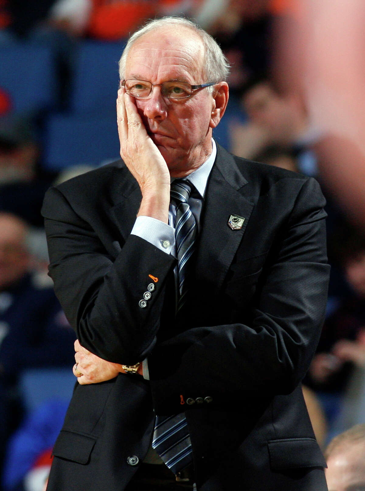FILE - In this March 20, 2014, file photo, Syracuse head coach Jim Boeheim watches his team play during the second half of a second-round game in the NCAA college basketball tournament in Buffalo, N.Y. Syracuse University announced Wednesday, Feb. 4, 2015, that it has instituted a self-imposed postseason ban for the current men's basketball season as part of its case pending before the NCAA Committee on Infractions. (AP Photo/Bill Wippert, File) ORG XMIT: NY157