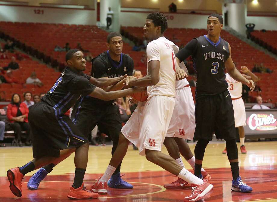 Tulsa Golden Hurricane guard Rashad Ray (5) and Houston Cougars forward Danrad Knowles (0) in the second half in a NCAA basketball game on Thursday, February 5, 2015 at Hofheinz Pavilion in Houston, TX. Tulsa won 57 to 44. Photo: Thomas B. Shea, For The Chronicle / © 2014 Thomas B. Shea