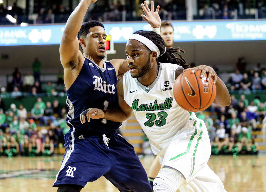 Marshall's Justin Edmonds (23) drives baseline on Rice defender Max Guercy (1) during an NCAA college basketball game, Thursday, Feb. 5, 2015, at the Cam Henderson Center in Huntington, W.Va. (AP Photo/The Herald-Dispatch, Sholten Singer) Photo: Sholten Singer, Associated Press / The Herald-Dispatch