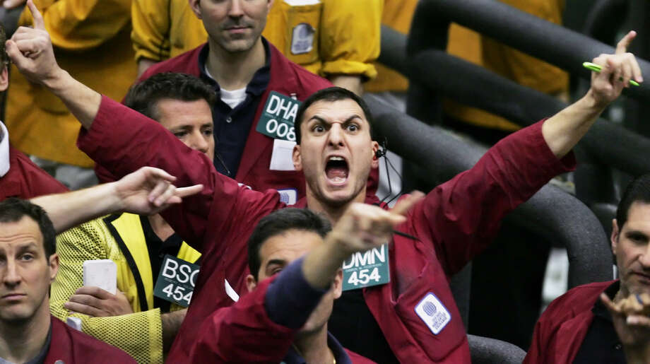 Damon Federighi shouts orders in the euro dollar futures pit at the Chicago Mercantile Exchange in this 2005 photo. Floor trading has shrunk to a fraction of its volume from two decades ago as computers take over establishing prices on everything from pigs to petroleum. Photo: M. SPENCER GREEN, STF / AP
