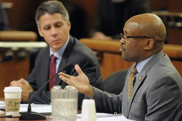 New York State Homes & Community Renewal Commissioner Daryl C. Townes, right, and Executive Director Ted Houghton take part in the 2015 housing budget hearings at the Legislative Office Building on Thursday Feb. 5, 2015 in Albany , N.Y.  (Michael P. Farrell/Times Union) Photo: Michael P. Farrell / 10030489A
