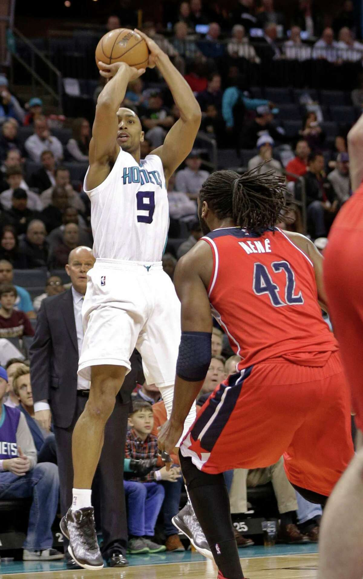 Charlotte Hornets' Gerald Henderson (9) shoots over Washington Wizards' Nene (42) during the first half of an NBA basketball game in Charlotte, N.C., Thursday, Feb. 5, 2015. (AP Photo/Chuck Burton) ORG XMIT: NCCB104