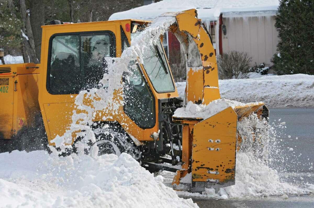 An industrial sized snow blower clears the sidewalk along Fuller Rd. on Thursday, Feb. 5, 2015 in Albany, N.Y. (Lori Van Buren / Times Union)
