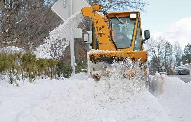 An industrial sized snow blower clears the sidewalk along Fuller Rd. on Thursday, Feb. 5, 2015 in Albany, N.Y. (Lori Van Buren / Times Union) Photo: Lori Van Buren