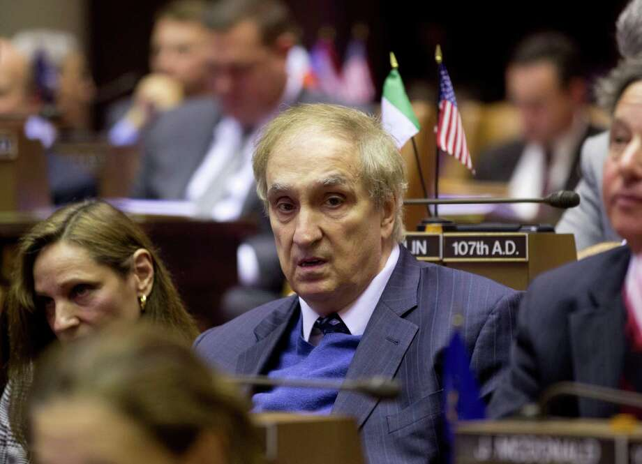FILE - In this Jan. 14, 2013 file photo, former Assemblyman Vito Lopez sits in the Assembly Chamber during session at the Capitol in Albany, N.Y. Two female legislative staffers who accused former state Assemblyman Vito Lopez of sexual harassment will receive $545,000 in taxpayer funds to settle their lawsuits against the former Brooklyn lawmaker and his fellow defendant, former Assembly Speaker Sheldon Silver. (AP Photo/Mike Groll, File) Photo: Mike Groll / AP