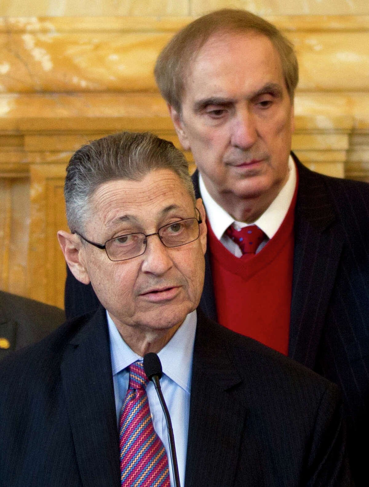 FILE - In this April 18, 2012 file photo, Assembly Speaker Sheldon Silver, D-Manhattan, speaks during an affordable housing news conference as Assemblyman Vito Lopez, D-Brooklyn, right, listens at the Capitol in Albany, N.Y. Accusations of sexual harassment that emerged over the summer have unraveled in public before a state ethics committee, revealing more sexual misconduct accusations against Lopez and a secret six-figure payoff to the accusers with taxpayer money that was approved by Silver. (AP Photo/Mike Groll, File)