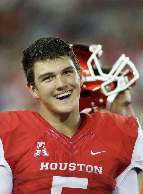 Houston Cougars quarterback John O'Korn (5) smiles after watching the second string score against the Grambling State Tigers in the second half on September 6, 2014 at John O'Quinn Field at TDECU Stadium in Houston, TX. (Photo: Thomas B. Shea/For the Chronicle) Photo: Thomas B. Shea, Freelance / © 2014 Thomas B. Shea