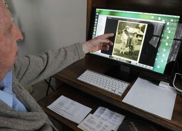 Sherwood Davies, 97, who grew up in the Sony Wold Sanatorium on Lake Kushaqua in the Adirondacks outside Saranac Lake talks of his experiences as he points to photograph of he and his mother taken at the TB sanatorium on Wednesday Feb. 4, 2015 in Troy, N.Y.  (Michael P. Farrell/Times Union) Photo: Michael P. Farrell / 00030473A