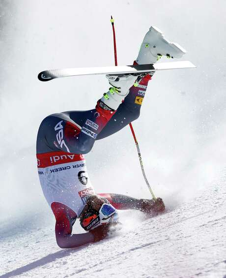 Bode Miller goes head over heels after crashing in Thursday's super-G competition at the Alpine World Championships at Beaver Creek, Colo. The U.S. skier tore a tendon in his leg and had surgery. Photo: Shinichiro Tanaka, HONS / Pentaphoto