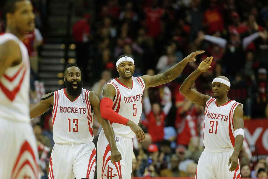 Forward Josh Smith (5) says he couldn't be happier with his new teammates and his new home after he was waived by Detroit and signed by the Rockets. Photo: Johnny Hanson, Staff / © 2014  Houston Chronicle