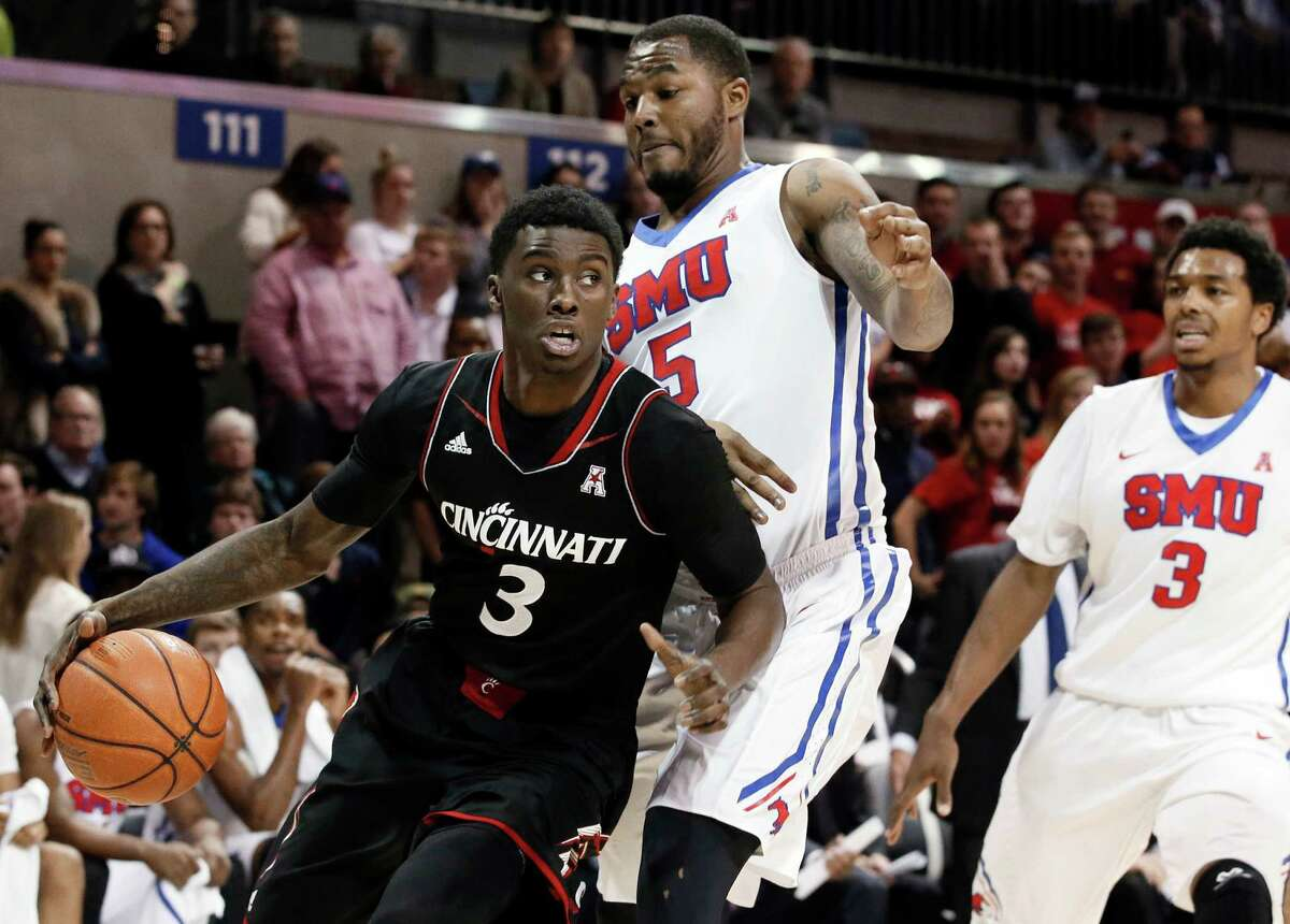 Cincinnati's Shaquille Thomas (3) drives the baseline past SMU's Markus Kennedy (5) as Sterling Brown (3) watches in the first half of an NCAA college basketball game Thursday, Feb. 5, 2015, in Dallas. (AP Photo/Tony Gutierrez) ORG XMIT: TXTG107