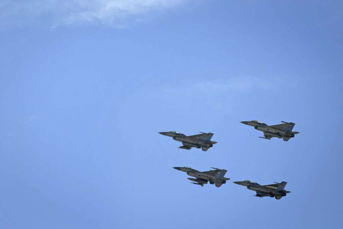 Jordanian Air Force fighter jets fly during the funeral of slain Jordanian pilot, Lt. Muath al-Kaseasbeh, at his home village of Ai, near Karak, Jordan, Wednesday, Feb. 4, 2015. Outrage and condemnation poured across the Middle East on Wednesday as horrified people learned of the video purportedly showing the Islamic State group burn a Jordanian pilot to death. (AP Photo/Nasser Nasser) ORG XMIT: NN110