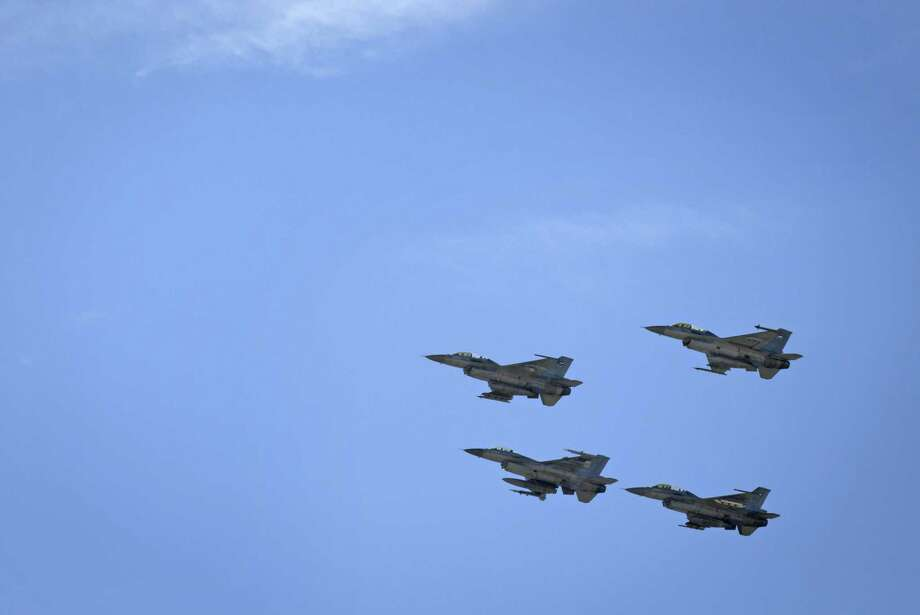 Jordanian Air Force fighter jets fly during the funeral of slain Jordanian pilot, Lt. Muath al-Kaseasbeh, at his home village of Ai, near Karak, Jordan, Wednesday, Feb. 4, 2015. Outrage and condemnation poured across the Middle East on Wednesday as horrified people learned of the video purportedly showing the Islamic State group burn a Jordanian pilot to death. (AP Photo/Nasser Nasser) ORG XMIT: NN110 Photo: Nasser Nasser / AP