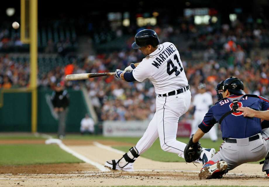 Tigers designated hitter Victor Martinez (41), shown hitting a two-run home run off Twins pitcher Trevor May in 2014, needs surgery on his left knee after injuring it during his offseason workout program for the second time in four years, the Tigers said Thursday. Martinez tore the medial meniscus in his knee and is scheduled for surgery Tuesday with Dr. James Andrews in Pensacola, Fla. Photo: Paul Sancya / Associated Press / AP