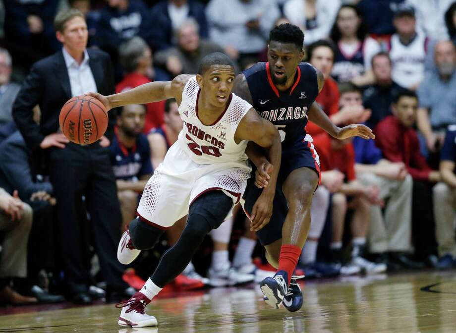 Santa Clara's Denzel Johnson (20) dribbles around Gonzaga's Gary Bell Jr. (5) during the first half in Santa Clara on Thursday night. Photo: Marcio Jose Sanchez / Associated Press / AP