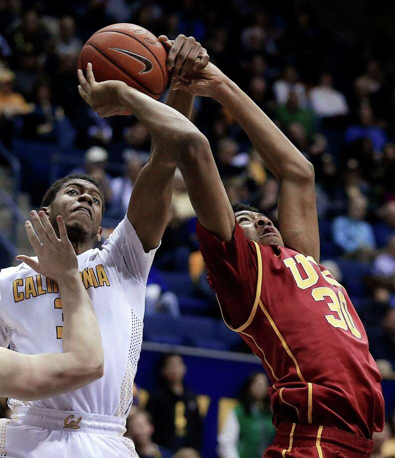 Cal's Tyrone Wallace tries to stop USC's Elijah Stewart from getting off a shot during the first half in Berkeley on Thursday night. Photo: Ben Margot / Associated Press / AP