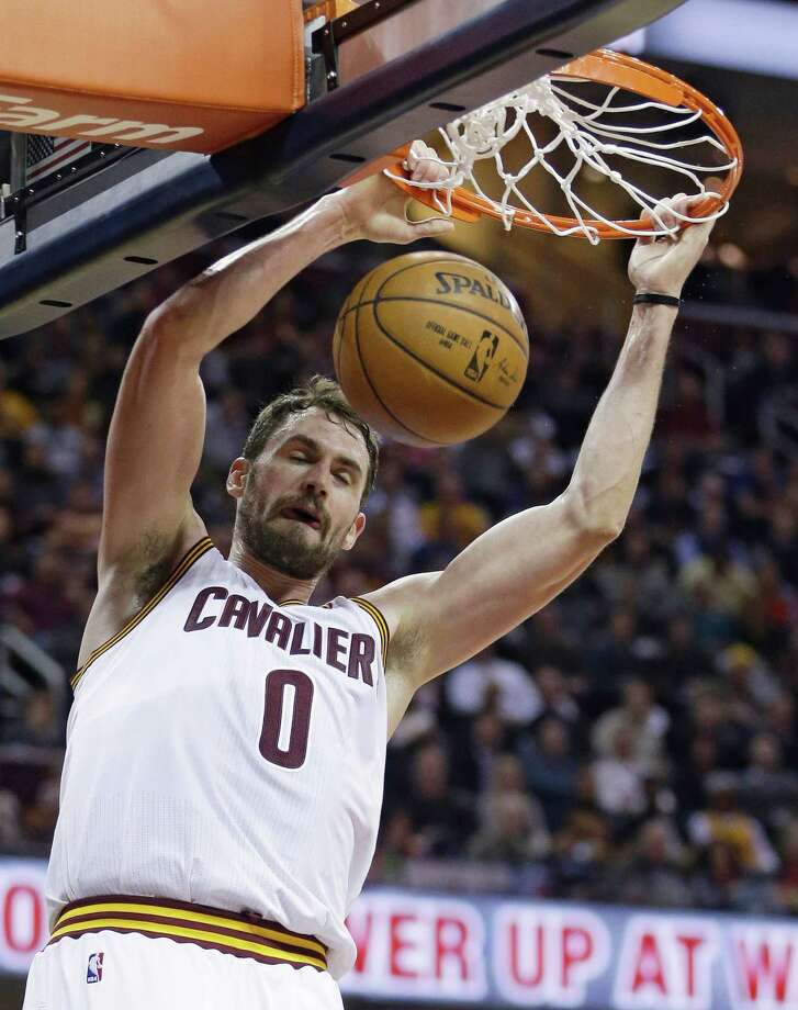 Cavs forward Kevin Love dunks against the Clippers during the second quarter in Cleveland on Thursday night. Photo: Tony Dejak / Associated Press / AP