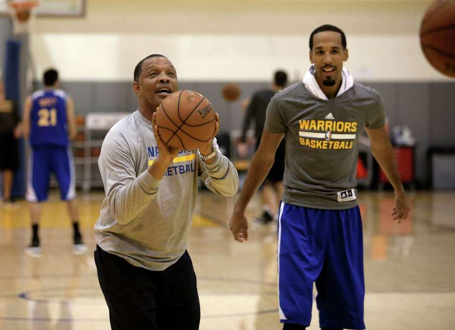 Assistant coach Alvin Gentry, (left) shoots baskets along with Shaun Livingston, (34) as the Golden State Warriors hold practice at their downtown Oakland, Calif., facility on Tuesday Sept. 30, 2014. Photo: Michael Macor / The Chronicle / ONLINE_YES