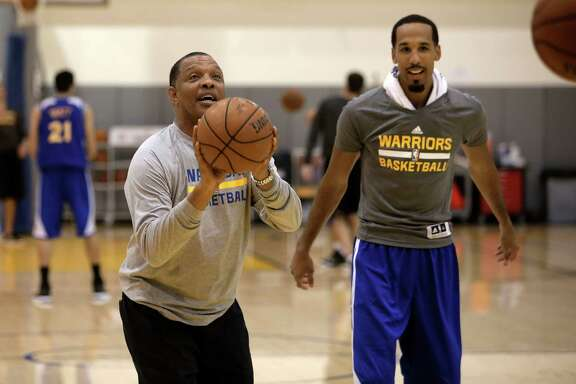 Assistant coach Alvin Gentry, (left) shoots baskets along with Shaun Livingston, (34) as the Golden State Warriors hold practice at their downtown Oakland, Calif., facility on Tuesday Sept. 30, 2014.