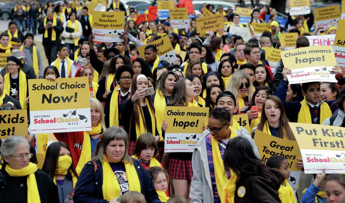 Students, teachers and supporters march on the grounds of the Texas Capitol Jan. 30. Despite the rally, the Legislature failed to pass school choice legislation.