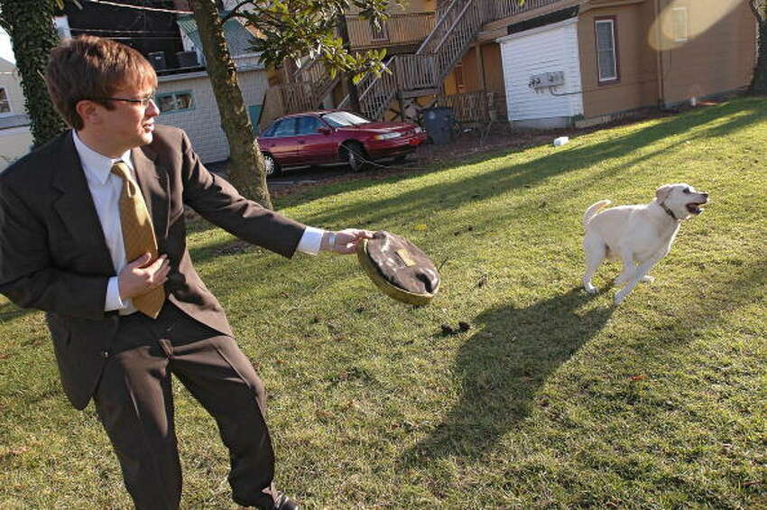 20. Delaware In this photo, John Rediker, an attorney for the investors of The Walt Disney Co., throws a Frisbee to his dog Jack, a yellow Labrador retriever, during some off time from working at the Disney vs Ovitz trial in Georgetown, Delaware, Monday, December 13, 2004.
