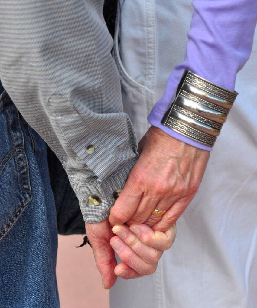 24. Santa Fe, New Mexico This photo shows a senior couple hold hands at an outdoor concert in Santa Fe, New Mexico on Sept. 23, 2012.