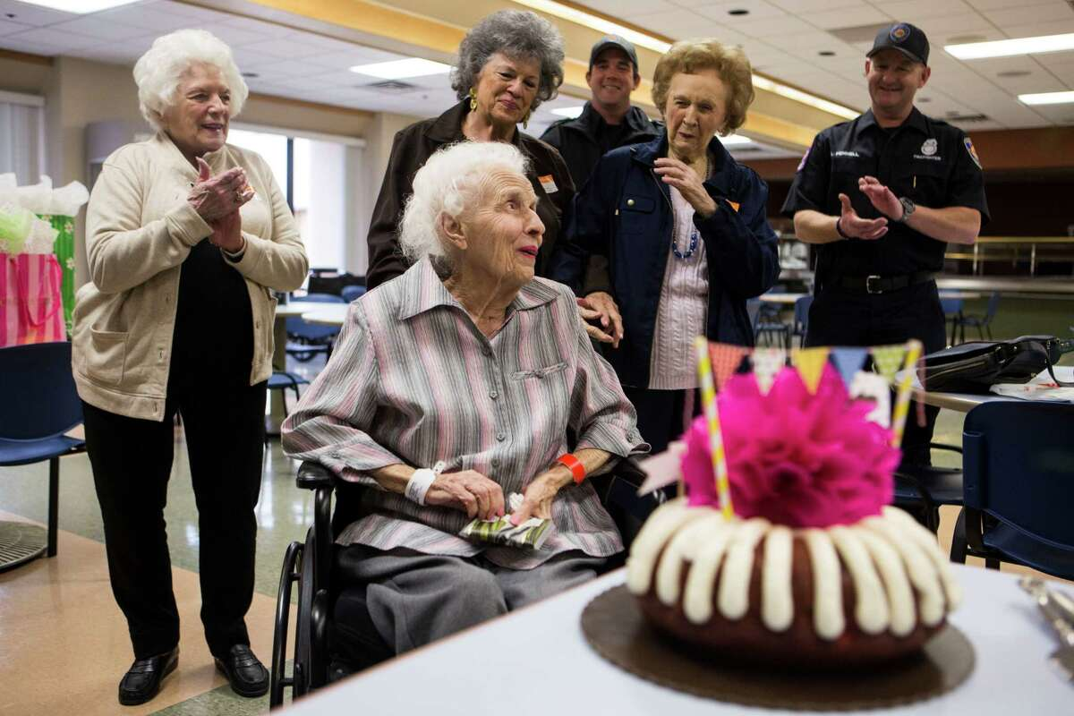 Catherine Olivet, 97, center, reacts to Barbara McConnell, left, Judy Carr, Greg Dehart, Dorothy Miller and Larry Fennell singing her a birthday song at the HealthSouth Rehabilitation Institute in San Antonio on Thursday, February 5, 2015. Olivet, McConnell and Miller were residents in Wedgwood during the fire. Carr was a caretaker at Wedgwood for 19 years. Fennell and Dehart were two of the Shavano Park firefighters who helped rescue the Wedgwood residents.