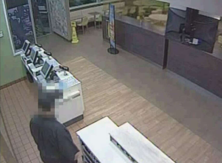 Authorities have released a surveillance video of an armed robbery last month at a fast-food restaurant in northeast Harris County. The heist happened about 8 p.m. in the 15000 block of Mesa Drive, according to the Harris County Sheriff's Office. Photo: Harris County Sheriff's Office
