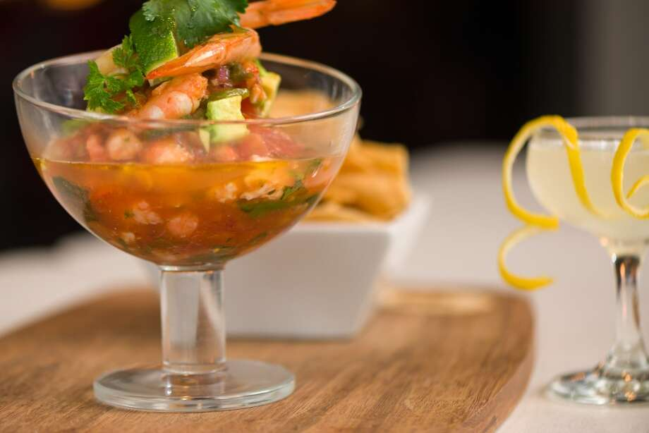 Classic Campechana: Gulf shrimp, jumbo lump crab, avocado and a spicy gazpacho broth at Henke & Pillot. The downtown lounge and kitchen's new menu has been created by consulting chef David Grossman. (Photo: Vladimir Ambia)