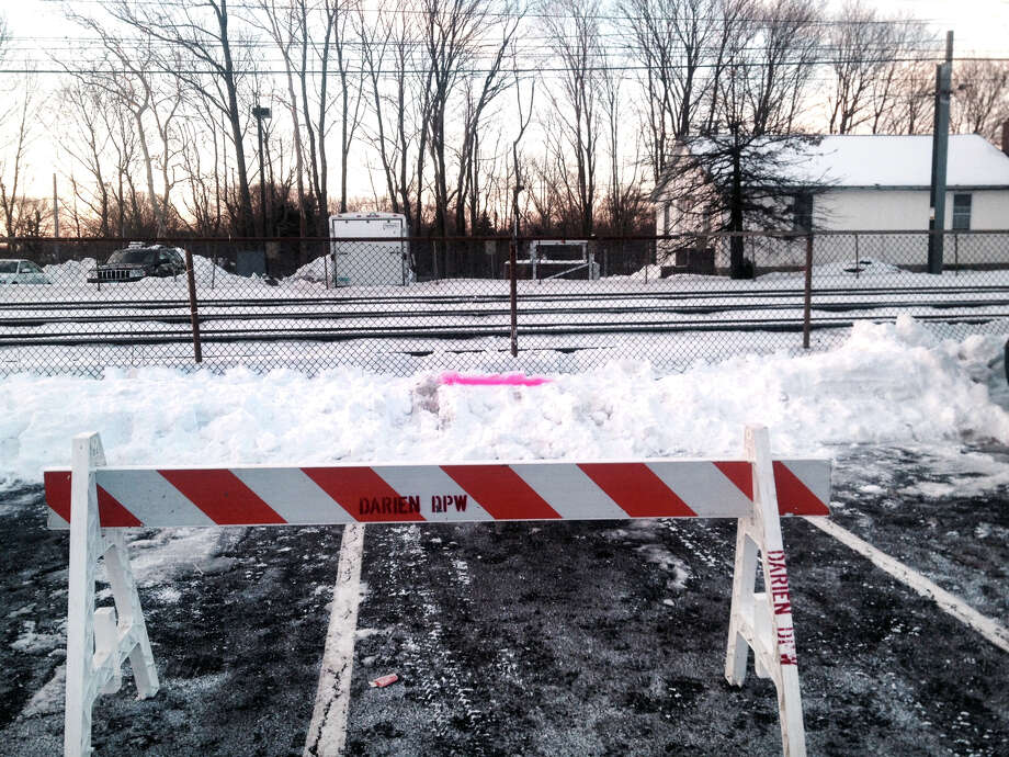 A rail commuter trying to park his car accidentally crashed through a fence near Metro-North Railroad train track in Darien, Conn.,  delaying the morning commute on Friday, Feb. 6, 2015. The Jeep vehicle knocked down a section of the Noroton Heights parking lot's fence and came within 10 feet of the tracks. The driver was not injured. Photo: John Nickerson / Stamford Advocate
