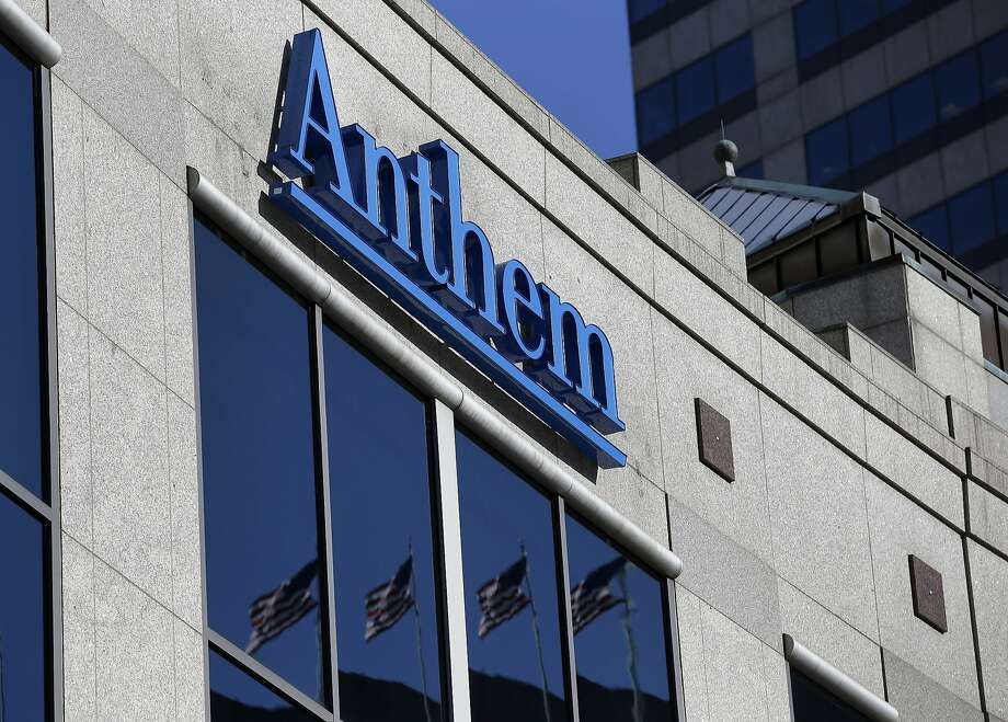 FILE - In this Feb. 5, 2015 file photo, the Anthem logo hangs at the health insurer's corporate headquarters in Indianapolis. Insurers aren't required to encrypt consumers' data under a 1990s federal law that remains the foundation for health care privacy in the Internet age _ a striking omission in light of the cyberattack against Anthem, the nation's second-largest health insurer.  (AP Photo/Michael Conroy, File) Photo: Michael Conroy, Associated Press