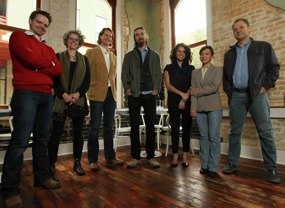 Architects Brantley Hightower (from left), Tenna Florian, Tobin Smith, Patrick Winn, Siboney Diaz-Sanchez, Nicki Marrone and Jonathan Card of the Seven to Watch pose for a portrait at Cured on Tuesday, Feb. 3, 2015. Photo: Kin Man Hui, San Antonio Express-News / ©2015 San Antonio Express-News