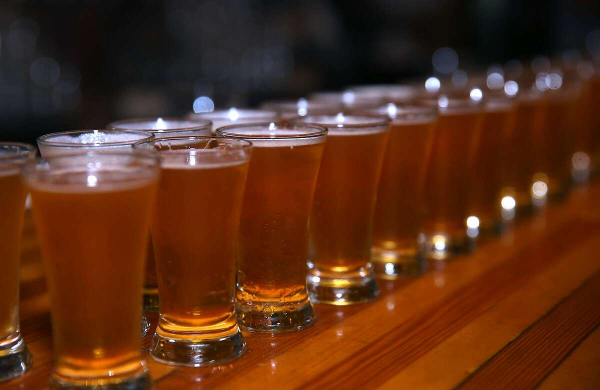 Glasses of Pliny the Younger India Pale Ale are lined up for an employee toast before the Russian River Brewing Company opens for customers in Santa Rosa, Calif. on Friday, Feb. 6, 2015. Beer lovers from across the country wait in long lines for a shot of sipping the IPA, listed at 10.25% ABV, during its 2-week limited availability.