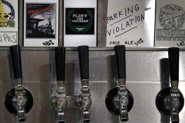 Pliny the Younger India Pale Ale is tapped and ready to pour at the Russian River Brewing Company in Santa Rosa, Calif. on Friday, Feb. 6, 2015. Beer lovers from across the country wait in long lines for a shot of sipping the IPA, listed at 10.25% ABV, during its 2-week limited availability.
