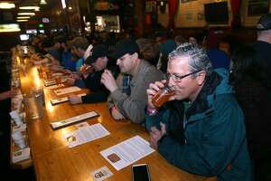 Lindsey Waddell sips on a glass of Pliny the Younger India Pale Ale at the Russian River Brewing Company in Santa Rosa, Calif. on Friday, Feb. 6, 2015. Beer lovers from across the country wait in long lines for a shot of sipping the IPA, listed at 10.25% ABV, during its 2-week limited availability.
