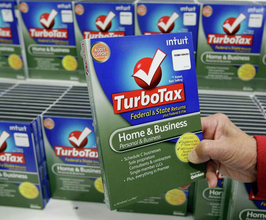 FILE - In this Jan. 24, 2013 file photo, a customer looks at a copy of TurboTax on sale at Costco in Mountain View, Calif. TurboTax says it has temporarily stopped processing state tax returns due to an increase in fraudulent fillings.  Intuit, the company behind the popular tax preparation software,  says state tax returns already filed since Thursday, Feb. 5, 2015,  will be transmitted as soon as possible. Users can still submit their federal income tax returns.(AP Photo/Paul Sakuma) Photo: Paul Sakuma / Associated Press / AP