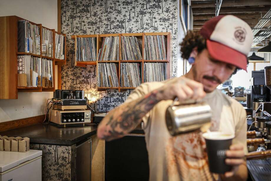 Four Barrel Coffee barista Bobby Sanchez makes a coffee drink on Monday, Feb. 2, 2015 in San Francisco, Calif.  Baristas change out the music that is curated by Jeremy Tooker, founder and owner, of Four Barrel Coffee. Photo: Russell Yip, The Chronicle