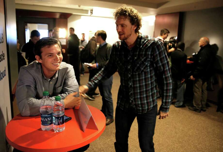 Gary Brown, (left) get a visit from Hunter Pence as the San Francisco Giants' hold a media availability at AT&T Park in San Francisco, Ca. on Friday Feb. 6, 2015. Photo: Michael Macor / The Chronicle / ONLINE_YES