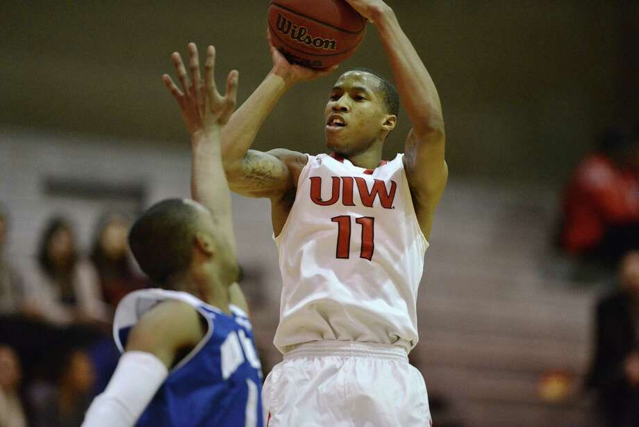 UIW's Denzel Livingston, the team's leading scorer, shoots the ball after a turnover during a game against New Orleans in San Antonio on Jan. 12, 2015. Photo: Matthew Busch /For The Express-News / © Matthew Busch