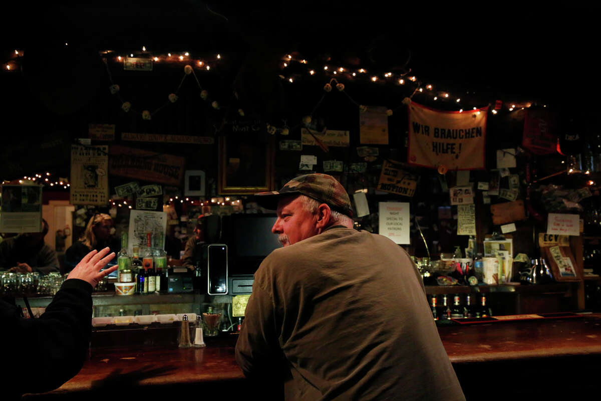 John King of Sutter Creek chats with Volcano veterinarian Karly Delano in the saloon next to St. George Hotel.
