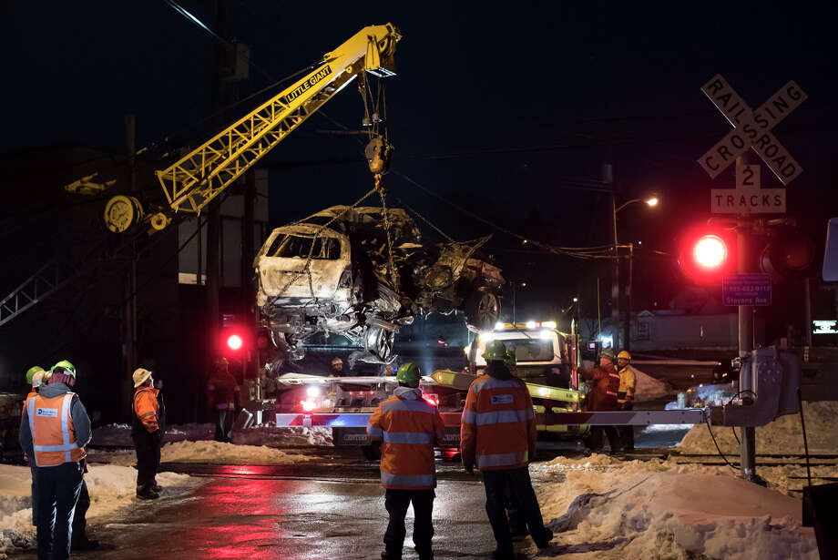 Workers use a crane to load the SUV involved in Tuesday's crash with a Metro North train. Photo: KARSTEN MORAN / New York Times / NYTNS