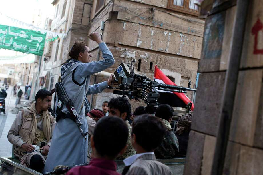 Flying the Yemeni flag, Shiite rebels ride in back of a truck with a mounted machine gun in the capital, Sanaa. Photo: TYLER HICKS / New York Times / NYTNS