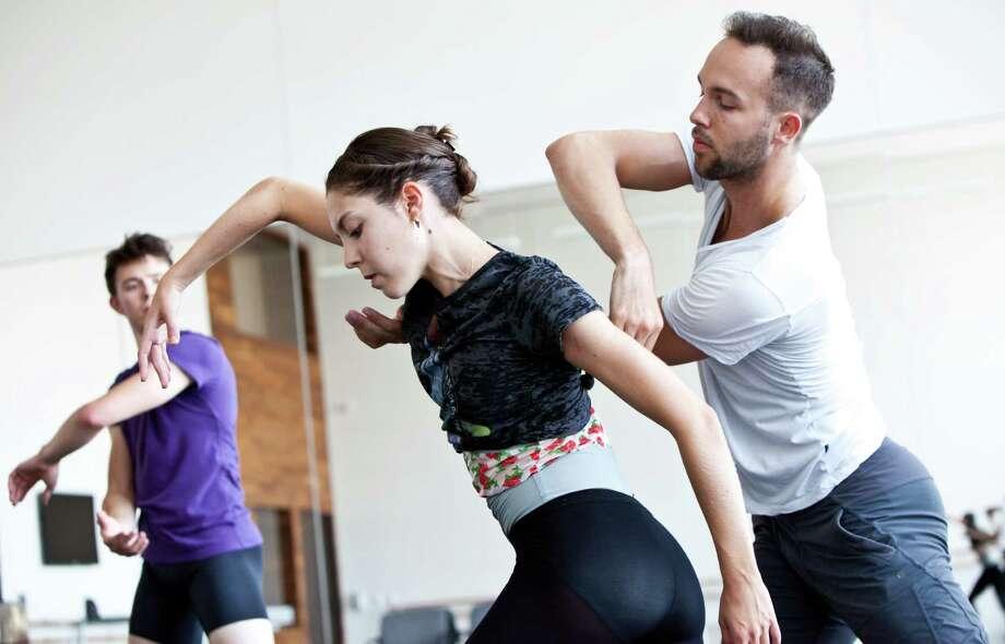 Choreographer Garrett Smith works with Houston Ballet dancers Katharine Precourt and William Newton. Smith will create a world premiere on the company for the 2015-2016 season. Photo: Amitava Sarkar / Amitava Sarkar