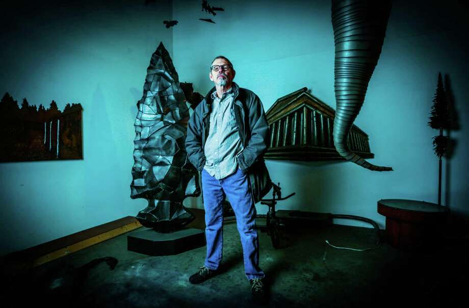 Ed Wilson posed recently with some of the sculpture in his large studio. Adjacent to his home, the studio is part of a near-northside compound developed by several Houston artists about 10 years ago. Photo: Billy Smith II, Staff / © 2015 Houston Chronicle