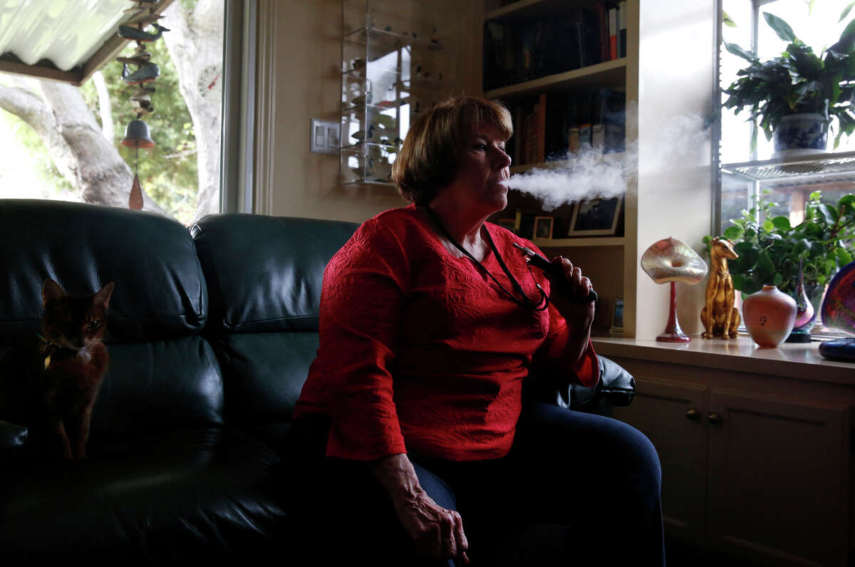 Roberta Keller, 72, uses her vaporizer in her Sunnyvale home. Keller, who smoked 1½ packs of cigarettes daily for more than 50 years, says she hasn't had a regular cigarette in 17 months.